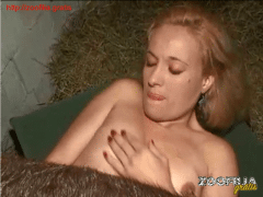 blonde woman fucks horse in the barn